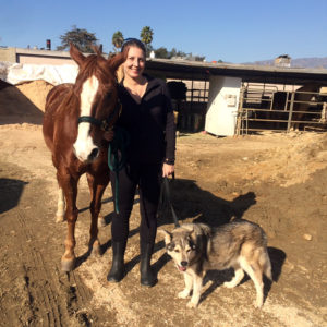 Heather with her horse Duke and first husky mix Echo